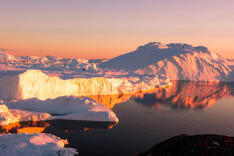 iceberg in Ilulissat Beauty In Nature Cold Temperature Eenland Environment Ice Iceberg Idyllic Lake Mountain Nature No People Non-urban Scene Outdoors Reflection Rock Scenics - Nature Sky Snow Snowcapped Mountain Sunset Tranquil Scene Tranquility Water