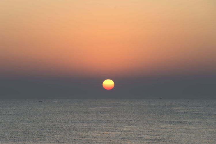 sunrise at Anmok Harbor in Gangreung, Gangwondo, South Korea Anmok Harbor Gangreung Beach Beauty In Nature Dawn Day Horizon Horizon Over Water In The Morning Nature No People Orange Color Outdoors Scenics Sea Silhouette Sky Sun Sunlight Sunrise Sunset Tranquil Scene Tranquility Water