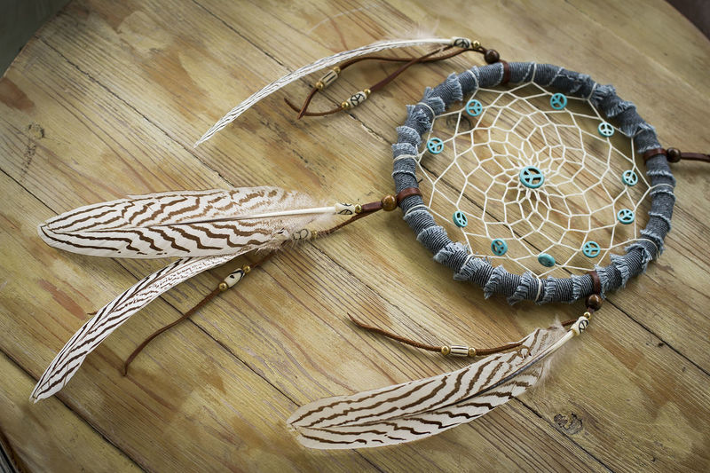 High Angle View Of Dreamcatcher On Wooden Table