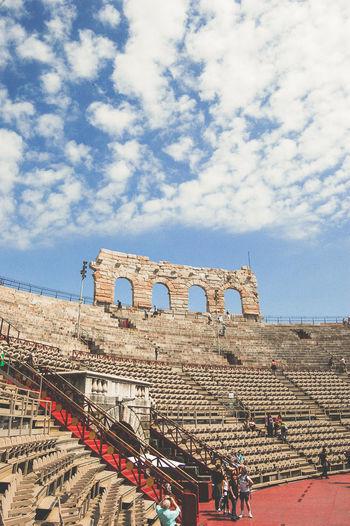 Amphitheatre historic building against blue cloudy sky