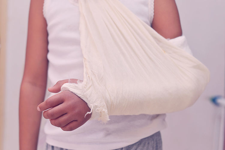 Midsection of woman with broken hand