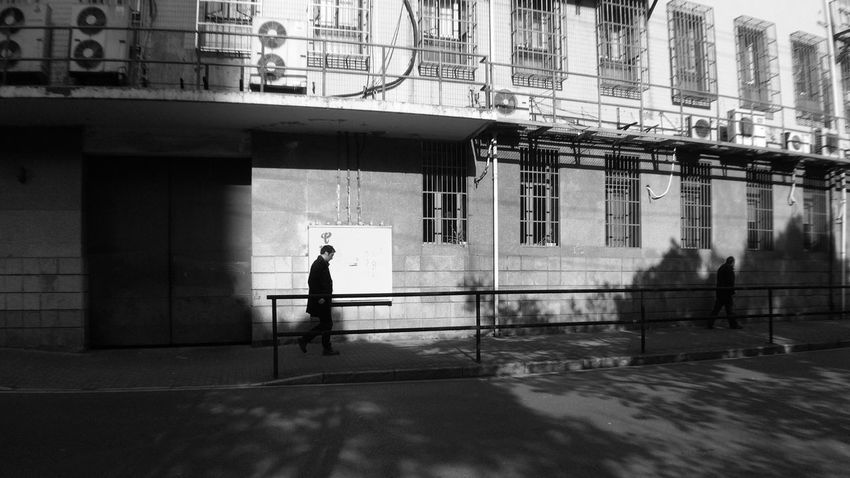 Streetphoto_bw IPhoneography Light And Shadow Blackandwhite Passing By