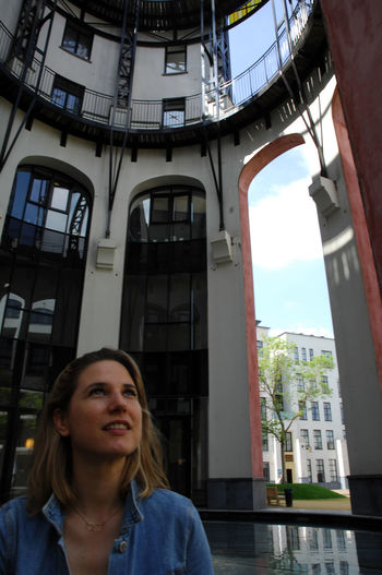 Architecture Built Structure Building Exterior Real People One Person Front View Window Portrait Women Day Building Leisure Activity Low Angle View Looking Lifestyles Looking Away Young Women Adult Outdoors Contemplation Hairstyle