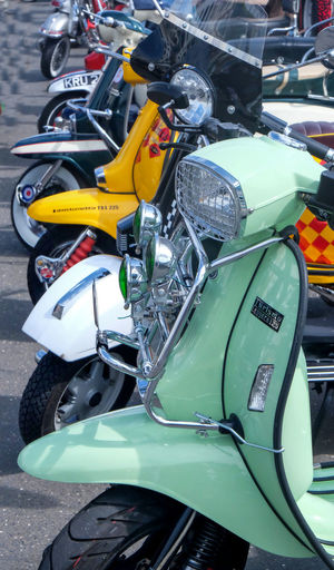 Green Moped Mopedlife Bicycle City Close-up Conjestion Day High Angle View In A Row Land Vehicle Mode Of Transportation Motor Scooter Motorcycle No People Outdoors Parking Parking Lot Road Scooter Stationary Street Transportation Wheel Yellow