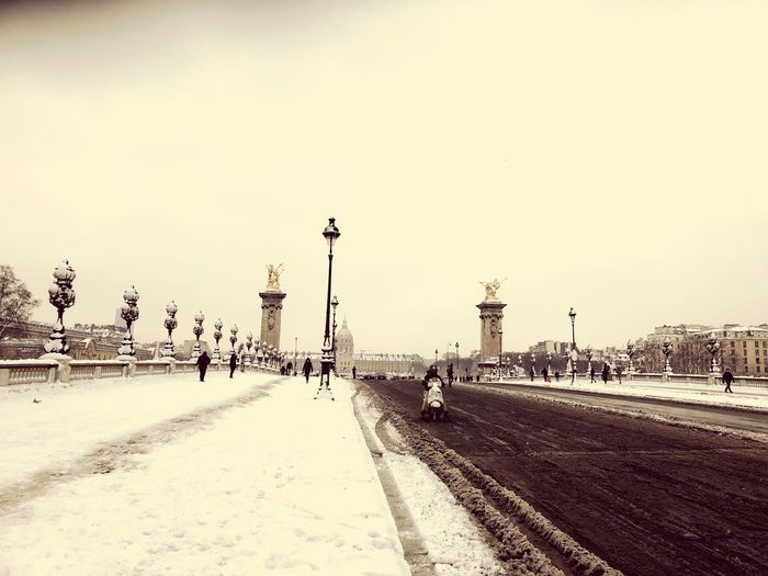 Snow in Paris Motocycle Snow Vintage Paris Hotel Des Invalides Invalides  Large Group Of People Real People Street Light Built Structure Travel Destinations Outdoors Architecture Road City Cold Temperature Winter