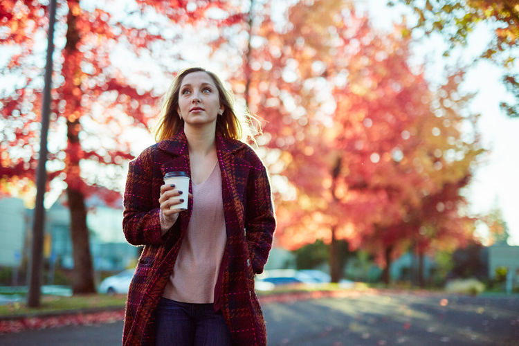Autumn Beautiful Woman Beauty Beauty In Nature Blond Hair Casual Clothing Day Focus On Foreground Front View Leaf Leisure Activity Lifestyles Long Hair Nature One Person One Young Woman Only Outdoors Park - Man Made Space Real People Scarf Smiling Standing Tree Young Adult Young Women