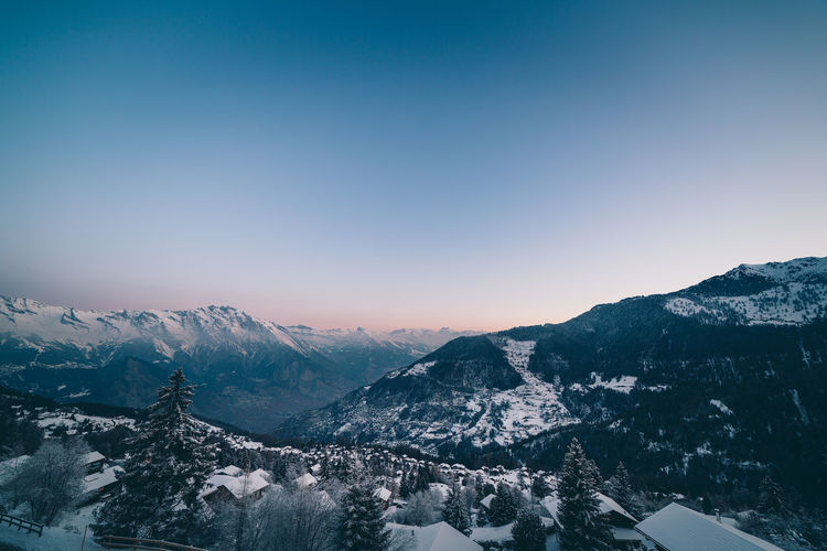 The swiss alps village of la tzoumaz at dawn in winter, valais, switzerland.