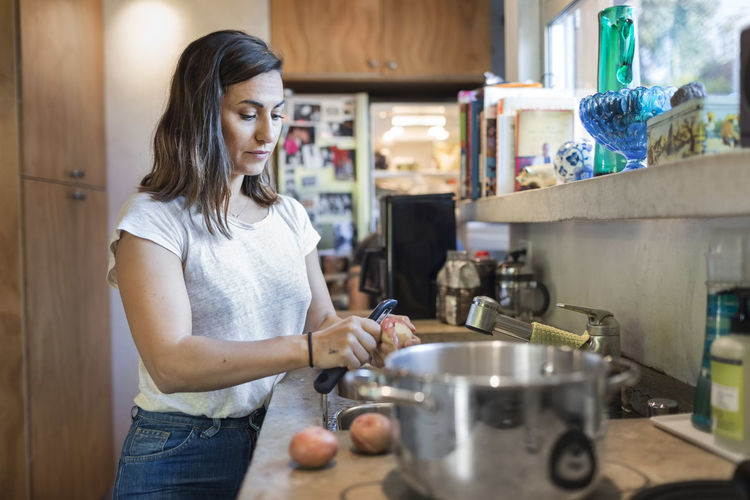 Midsection of woman holding food at home