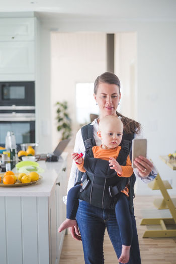 Portrait of woman holding food at home