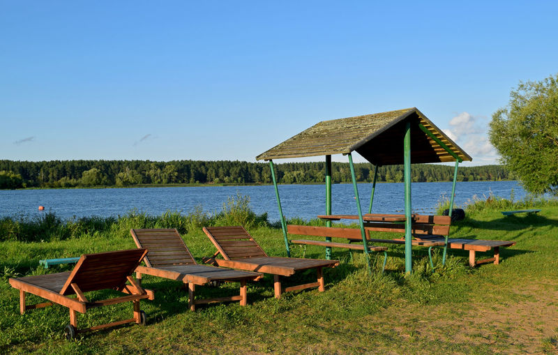 Recreation  Relaxing Riverside Absence Beauty In Nature Bench Blue Clear Sky Copy Space Day Empty Grass Land Nature No People Outdoors Plant Scenics - Nature Seat Sky Sunbathing Tranquil Scene Tranquility Volga Water