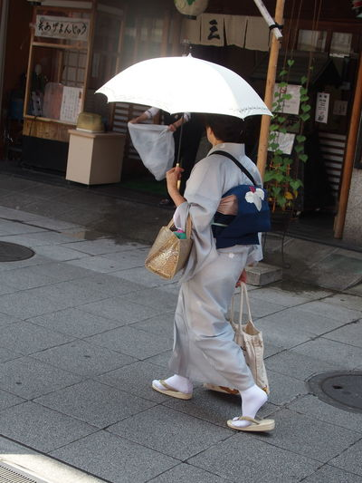 Japan Japanese Culture Traditional Clothing Footpath Japanese Lifestyle Japanese Street Japanese Women Kimono Lifestyles Protection Real People Street Umbrella Walking