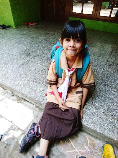 Portrait of girl wearing school uniform