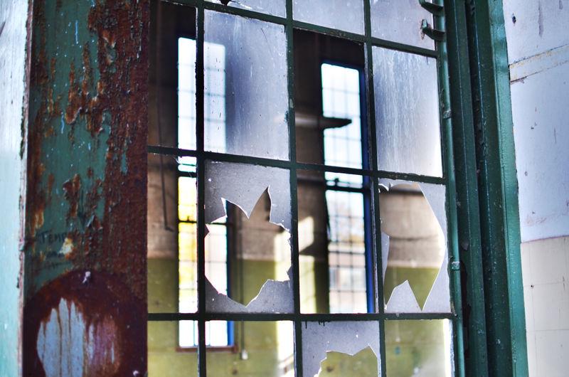 Broken glass window of a abandoned building
