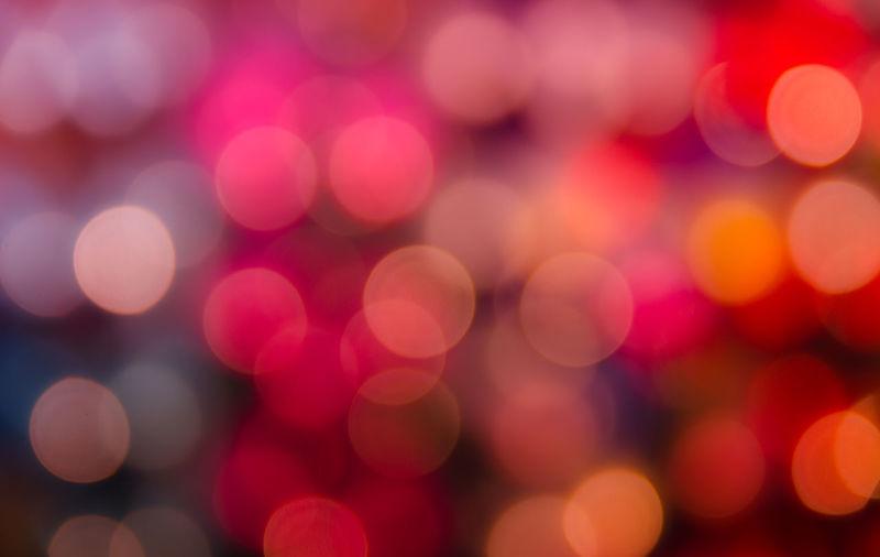 Defocused image of colorful illuminated lights at night