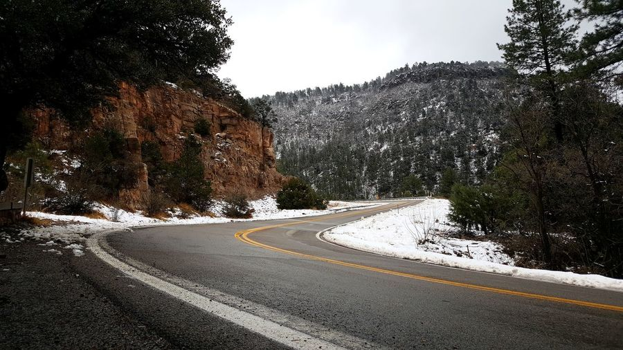 mingus mountain Arizona love the view here after it's snowed Snow Winding Road Darkness And Light Dark Sky Grey Sky Fog Mingus Mountain Mountain Snowcapped Mountain Winter The Way Forward No People Day