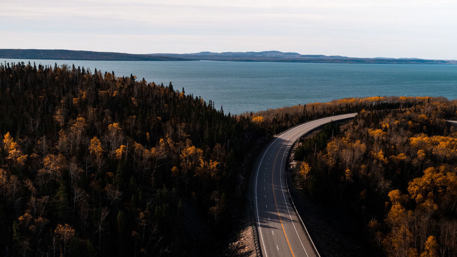 High Angle View Of Road By Sea During Autumn