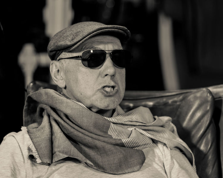 The Secret Life Of Don Giancarlo (Series of Selfies; Hat, Cap, Scarf, Eyeglasses, sunglasses, Mobile Phone, three point lighting, Pentax K-1 on tripod remote control via Smartphone App) Acting Hat Old Man Sitting Storytelling Acting Crazy Cap Close-up Day Expressions Feelings Focus On Foreground One Person Outdoors People Real People Scarf Selfie Series Sunglass  Sunglasses