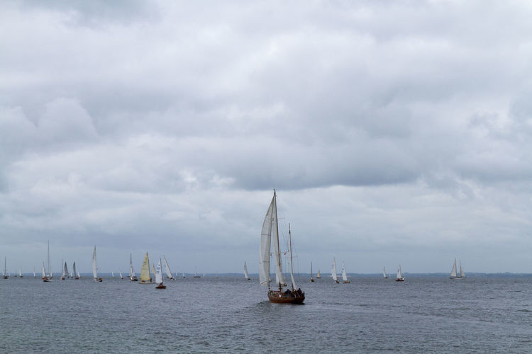 Beauty In Nature Boat Cloud Cloud - Sky Cloudy Day Feel The Journey Mast Mode Of Transport Nature Nautical Vessel No People Outdoors Overcast Sailboat Sailing Scenics Sea Ship Sky Tranquil Scene Tranquility Water Waterfront Weather