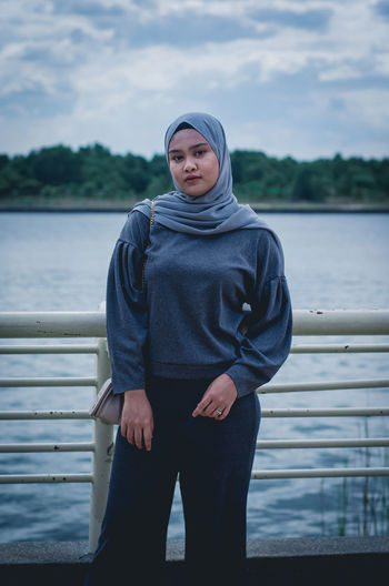 EyeEm Selects Portrait Water Politics And Government Standing Looking At Camera Lake Beauty Relaxation Young Women Front View Thoughtful Friend Lotus Position Calm Sweater International Women's Day 2019
