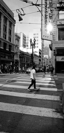boarding down downtown san francisco Architecture Building Exterior Built Structure City City Life City Street Crossing Day Full Length Large Group Of People Men Outdoors Pedestrian People Real People Road Road Marking Skate Boarding  Sky Stoplight Street Street Light Transportation Walking Zebra Crossing