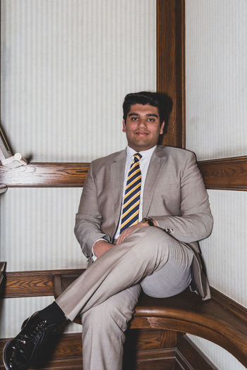Portrait of young businessman sitting at home