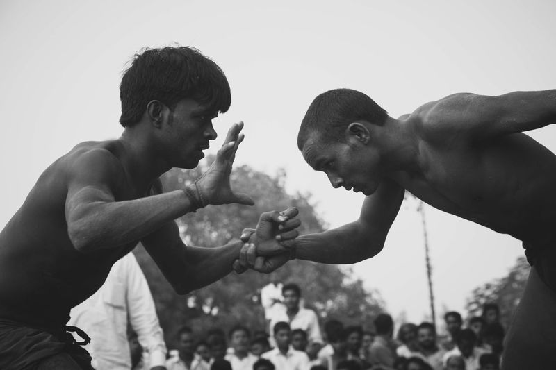 Dangal, also known as Kushti, is an Indian form of wrestling played in mud. It is still popular form of entertainment and spoort in smaller towns and villages in India. Pictured here is a local competition held in a popular fair in Deva, Barabanki, India. Dangal India Indian Wrestling Kushti Sports Street Photography Streetphotography The Street Photographer - 2017 EyeEm Awards Wrestling Mix Yourself A Good Time Done That. Be. Ready.
