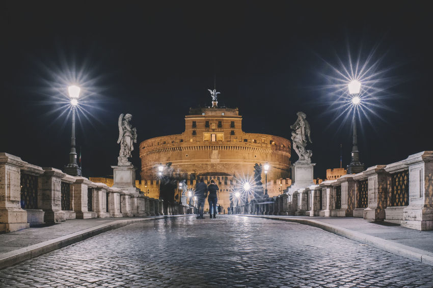 Castel Sant'Angelo Castle Arch Architecture Building Exterior Built Structure City History Illuminated Large Group Of People Light Beam Night Outdoors People Sculpture Sky Statue Street Light Tourism Town Square Travel Travel Destinations