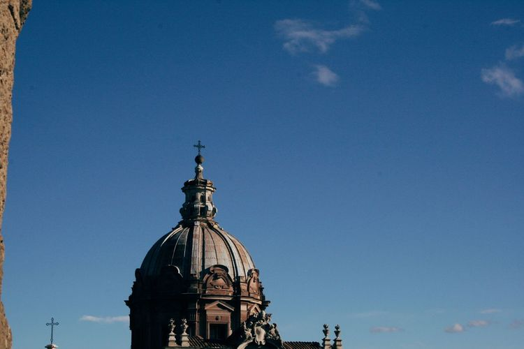 Statue of cathedral against blue sky