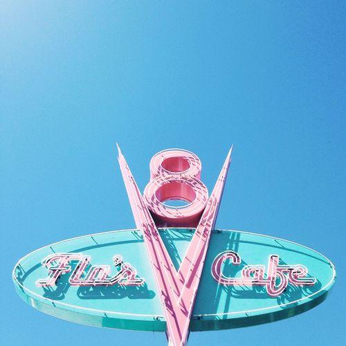 Close-up of amusement park ride against blue sky