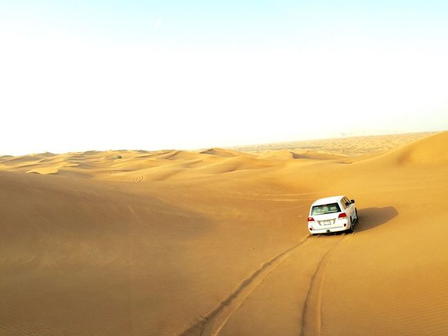 Car Desert Sand Dune Sand Sports Utility Vehicle Transportation Mode Of Transport Land Vehicle Off-road Vehicle 4x4 Outdoors Travel Nature Landscape Arid Climate Tire Track Sky Clear Sky Beauty In Nature Scenics UAE Dubai