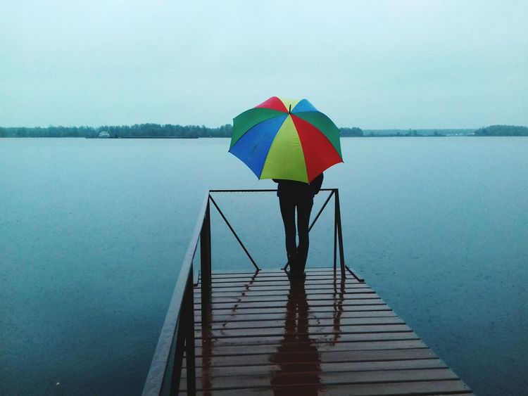 Rear View Water Lake One Person Outdoors Nature Tranquility Adult Day One Man Only Sky People Adults Only Beach Rain Water_collection Relaxing Narute Umbrella Only Women