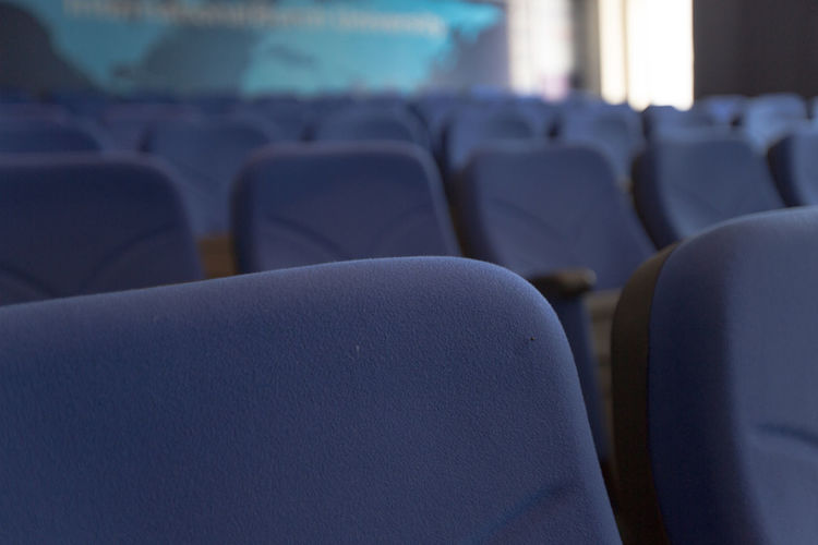 Close-up of empty chairs in stadium