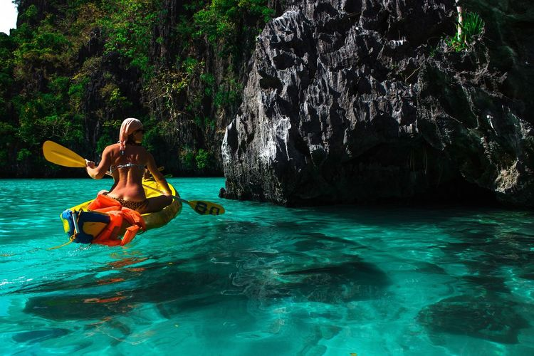 Perfect holiday in Paradise Holiday Perfect Paradise Travel Water Tree Women Beauty Happiness Beautiful People Smiling Young Women Swimming Kayak Life Jacket Turquoise Colored Stay Out