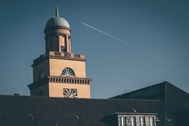 Low angle view of witten town hall against sky