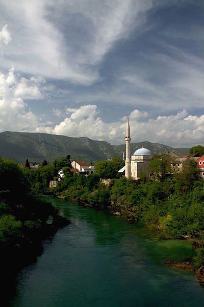 Mostar Water Sky Architecture Built Structure Travel Destinations Building Exterior River Outdoors Cloud - Sky No People Bridge - Man Made Structure Day Nature Reservoir City Life EyeEmNewHere EyeEm Best Shots Mostar ♥ Bosnia And Herzegovina Europe Trip Mostarbridge Mostar Bosnia Neretva Bosniaandherzegovina