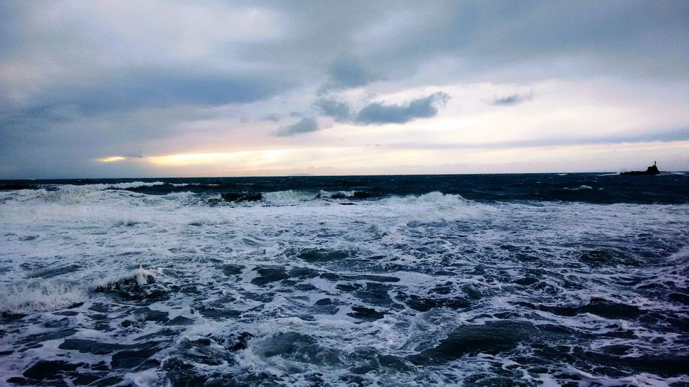 As sometimes a person can feel her heart torn apart, sometimes the sea can feel its waves which crash on it. But for both there is always a light after the storm. Rough Sea Waves Crashing Brokenheart Hope Change Encounters at Livorno, Italia / Leghorn, Italy