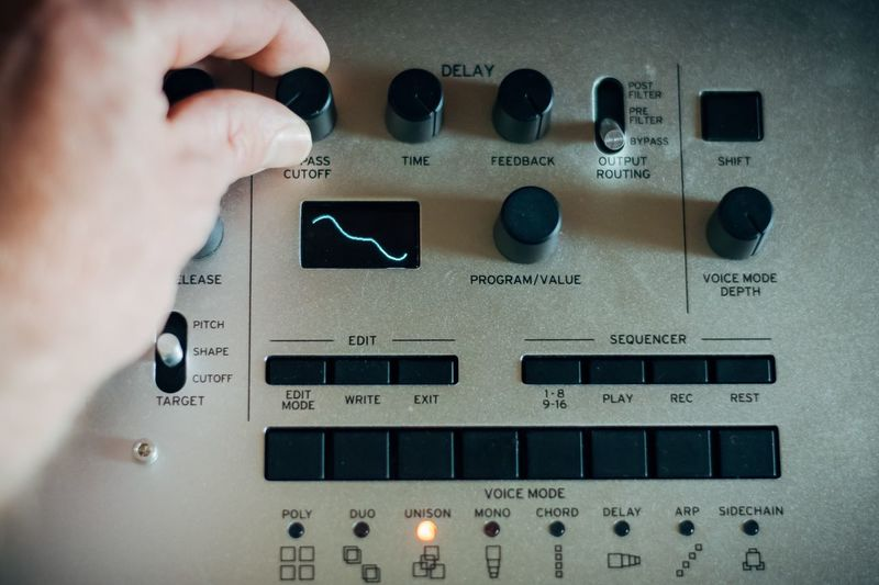 Close-up of person hand using audio equipment