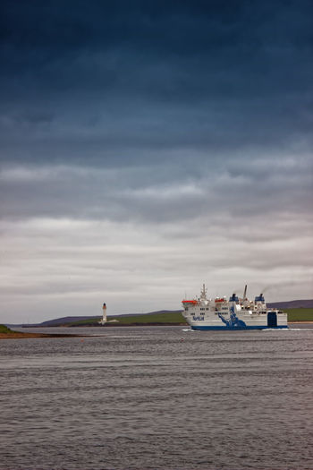Stromness Harbour, Orkney Island, Scotland Cruise Ship Ferry Harbour Inter Island Ferries Art Gallery Boat Ramp Cruise Ship House Island Life Ring Mode Of Transportation Nautical Vessel North Sea Passenger Craft Port Post Office Red Tin Tourism Town Tranquility Travel Destinations