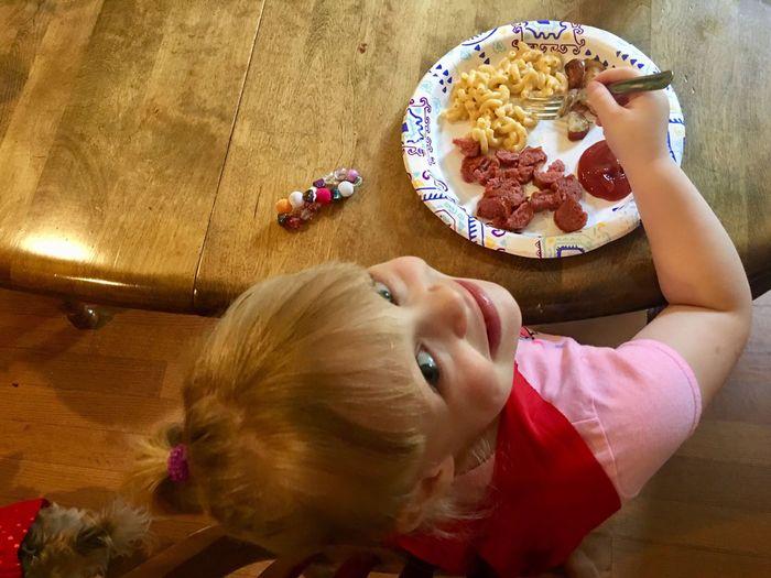 High angle view of girl having food at home