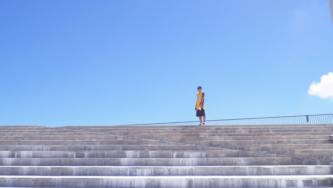 full length, one person, copy space, real people, blue, lifestyles, outdoors, leisure activity, day, clear sky, women, nature, young adult, sky, adult, people