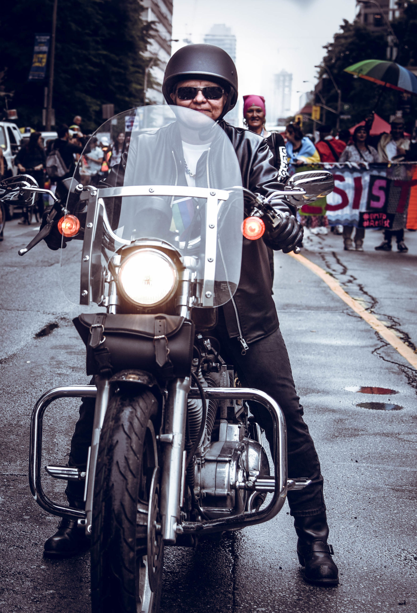 PORTRAIT OF MAN RIDING MOTORCYCLE ON STREET