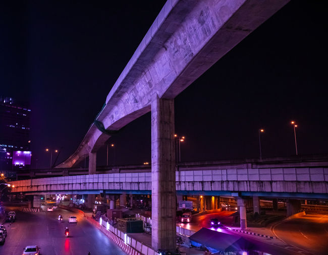 cross bridge - Bangkok - serie incandescence Illuminated Night Architecture Built Structure Bridge Transportation Bridge - Man Made Structure City Road Sky Building Exterior Street Connection Motion No People Elevated Road Long Exposure Architectural Column City Life Light Purple Bangkok Cyberpunk Neon Glowing