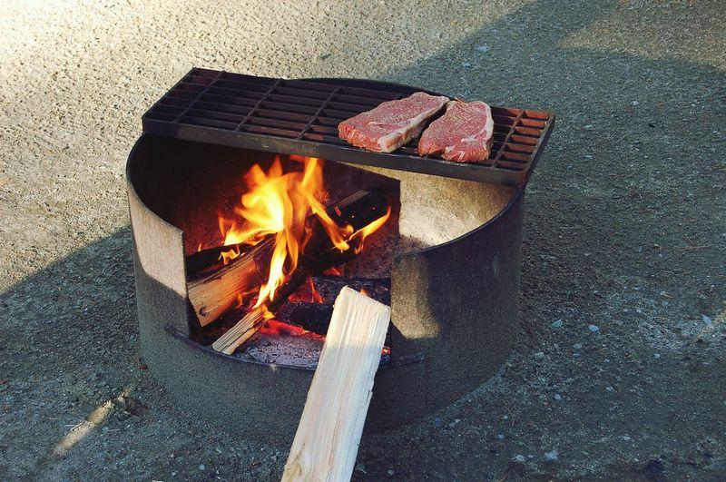 Wood burning stove on footpath