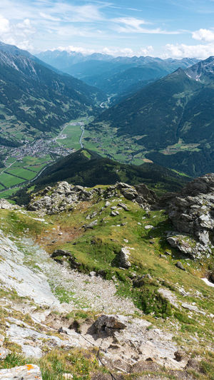 Aerial view of valley and mountains against sky