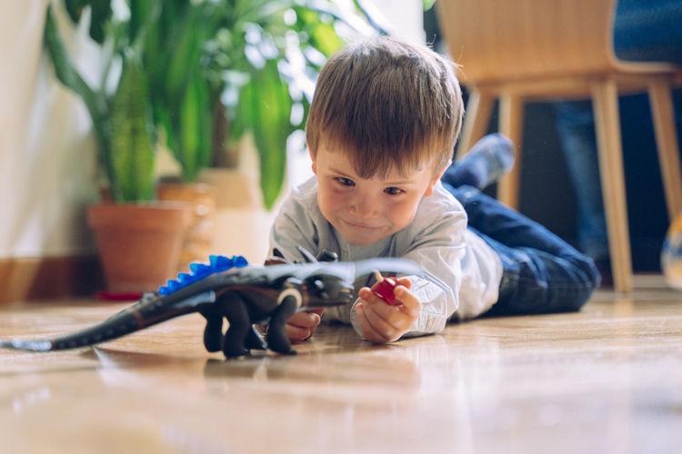 Boy lying down on floor