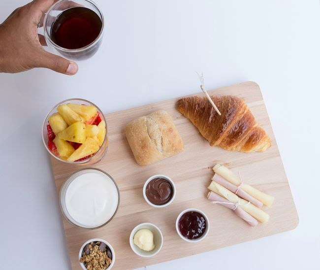 High Angle View Food And Drink Indoors  Human Hand Human Body Part Sweet Food One Person Bowl Only Women Food People Nail Polish One Woman Only Freshness Adult White Background Adults Only Day Ready-to-eat Food Styling Yogurt Croissant Healthy Eating Bread Breakfast