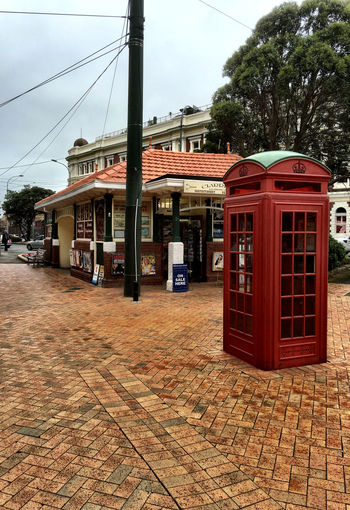Red phone box in front of Clarries Wellington  Red Phone Boxes Phone Booth Red
