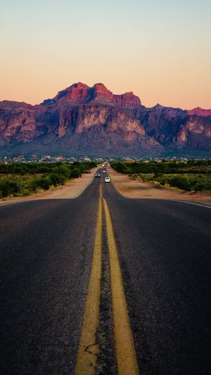 Road to Superstition Mountains. Arizona Lost Dutchman Mountains Adventure Travel Road Direction Transportation The Way Forward Sky Road Marking Marking Symbol Diminishing Perspective Nature No People vanishing point Landscape Mountain Asphalt Environment Scenics - Nature