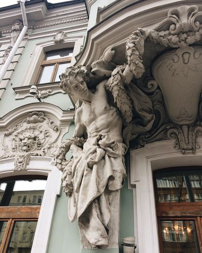 Statue Sculpture Low Angle View Art And Craft Architecture Building Exterior Built Structure Human Representation Creativity Outdoors Architectural Column No People Female Likeness Bas Relief Day