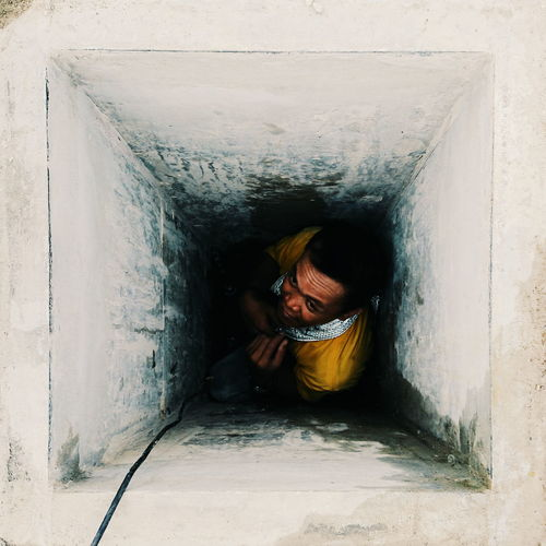 High angle view of man in hole